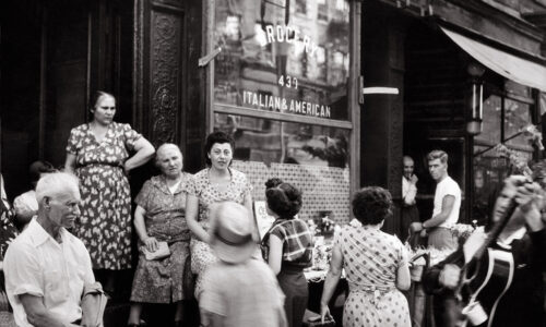 Women in Little Italy; Some Italian American women conversing with each other in front of a grocery store in Little Italy. New York, 1950s, MondadoriEverett Collection (AA083127)
